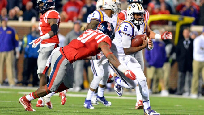 Junior DeMarquis Gates (31) attempts to tackle LSU quarterback Brandon Harris (6) during the fourth quarter of the game at Vaught-Hemingway Stadium. Gates is expected to start at outside linebacker this fall.