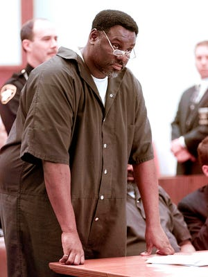 In this April 6, 2000 file photo, Nathaniel Cook stands during his sentencing at Lucas County Courthouse in Toledo. Nathaniel Cook, one of two brothers who admitted killing a 12-year-old girl during a string of murders in the early 1980s could get out of prison within months. Cook admitted he took part in three of those slayings with his brother, Anthony Cook, who's now serving two life sentences. A judge has set a hearing for Thursday, March 8, 2018, to begin determining whether Cook should be registered as a sex offender if he's released.