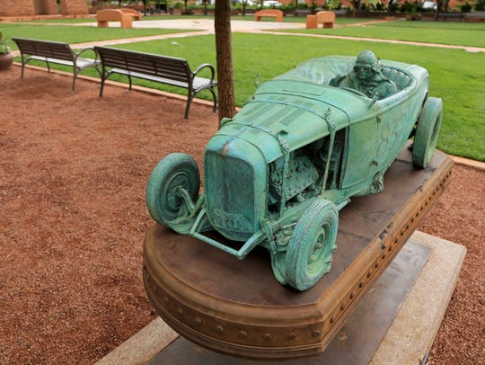 """""""Flat-Out,"""" a sculpture by Stanley Wanless, is part"""