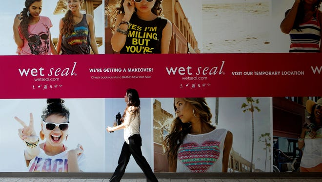 FILE - In this July 2, 2013, file photo, Shianne Penoli walks past the future location of Wet Seal at the Mount Shasta Mall in Redding, Calif.  Wet Seal, a teen clothing retailer, has filed for Chapter 11 bankruptcy protection, the company announced Friday, Jan. 16, 2015. (AP Photo/Record Searchlight, Greg Barnette, File) ORG XMIT: CARED201