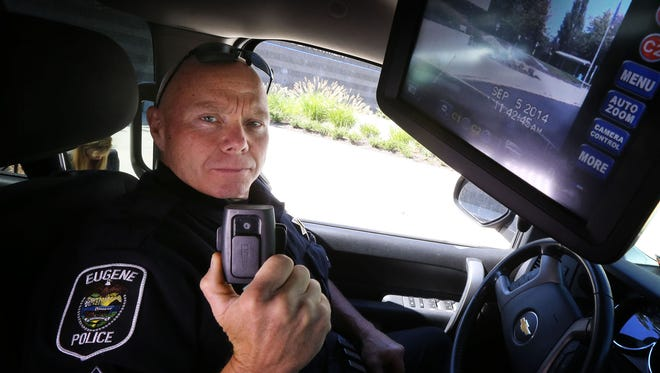 Eugene Police Sgt. Larry Compton displays his body camera along with the monitor for his police car camera in Eugene on Sept. 5, 2014.