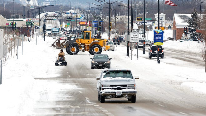 Nearly ten inches of snow greeted commuters Tuesday morning in Fond du Lac after the first major storm of the winter season swept through the area. City and county snowplows spent the day clearing roads of snowpack.