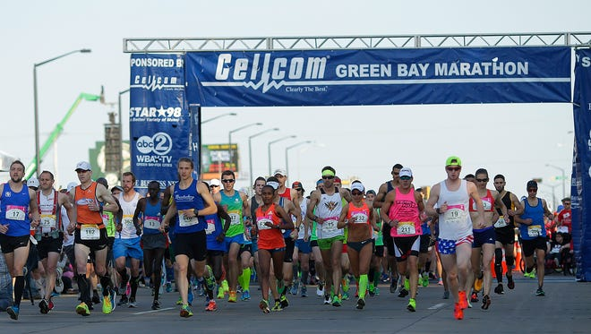 Runners take off from the start line during the Cellcom Green Bay Marathon in Green Bay on Sunday, May 22, 2016.