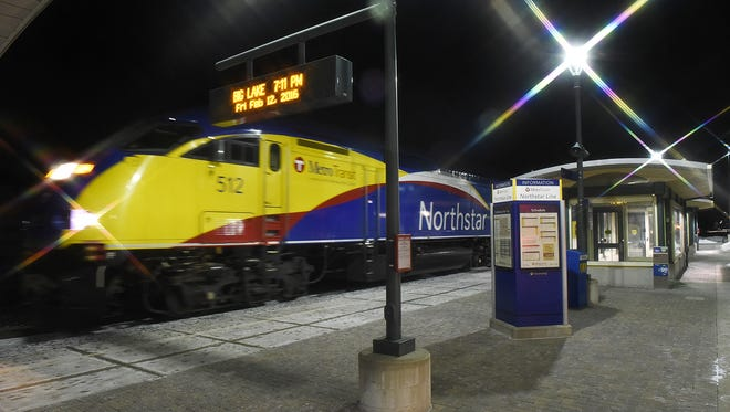 The Northstar commuter train pulls into the Big Lake Station Friday, Feb. 12, 2016, with the last commuters of the day in Big Lake. The photo was taken with a star filter to flare the lights.