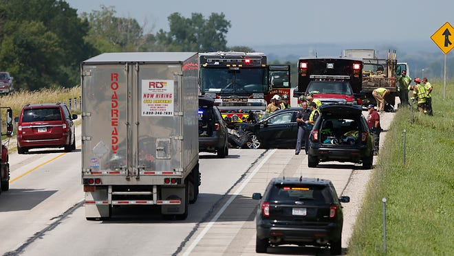 Emergency officials work the scene of a crash Tuesday on I-41 just north of County Road B in Fond du Lac County. August 1, 2017. 80-year-old Jerry Demlow of Antigo died as a result of the crash, when he failed to slow in traffic due to a backup, and collided with the straight truck, the Wisconsin State Patrol said.  Doug Raflik/USA TODAY NETWORK-Wisconsin