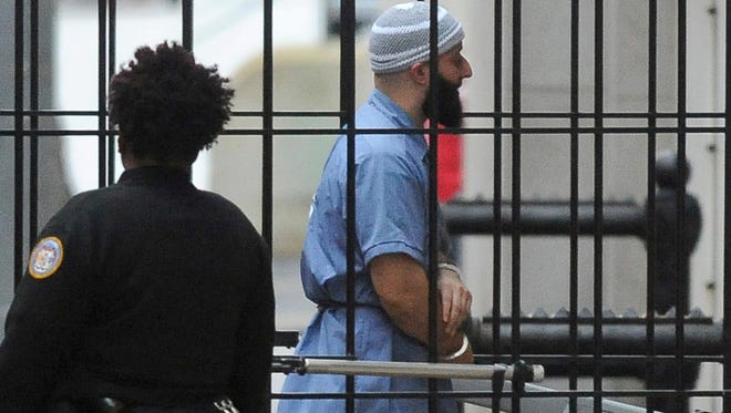 """FILE - In this Feb. 3, 2016 file photo, Adnan Syed enters Courthouse East in Baltimore prior to a hearing.    A Maryland appeals court has upheld a ruling, Thursday, March 29, 2018,  granting a new trial to Syed, whose conviction in the murder of his high school sweetheart became the subject of the popular podcast """"Serial."""" Syed was convicted in 2000 of killing Hae Min Lee and burying her body in a shallow grave in a Baltimore park. A three-judge panel on Thursday upheld a lower court ruling granting him new trial."""