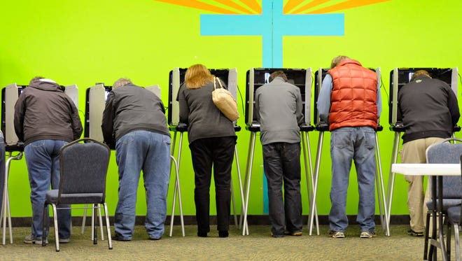 Voters fill in their ballots at Sartell Precinct 7  at Celebration Lutheran Church on Tuesday.