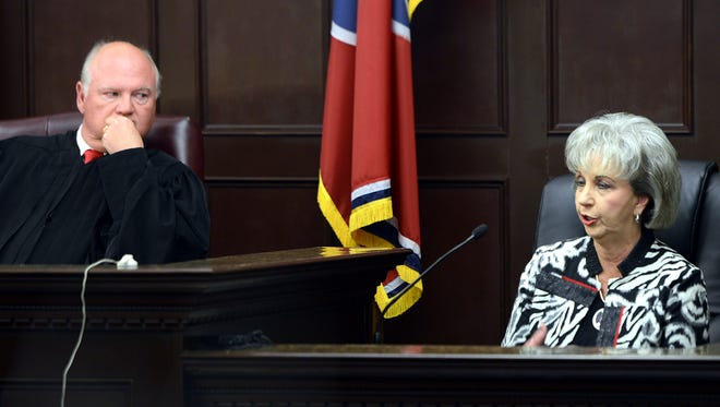 Judge Don Ash listens as Madison County Sheriff 's Department employee Rose Cash testifies on behalf of former sheriff David Woolfork in Chancery Court in this Feb. 5, 2014 file photo.