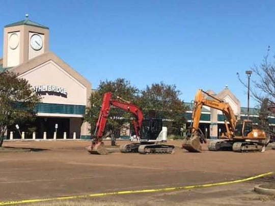 "Heavy equipment prepares to attack the ""annex"" of Lakeland Factory Outlet Mall as demolition begins on the former shopping district.10/26/2017"