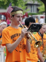 Riley Horne plays in the marching band as the parade