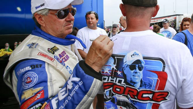NHRA legend John Force, signing an autograph at Heartland Motorsports Park, announced Friday that John Force Racing's four-car team will sit out the remainder of the 2020 season.