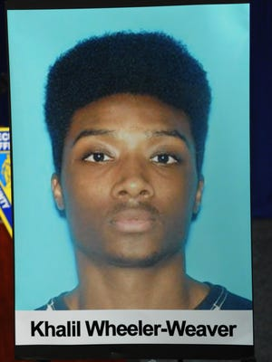 A photo of suspect Khalil Wheeler-Weaver is displayed at the press conference announcing his arrest in the murder of Sara Butler of Montclair.