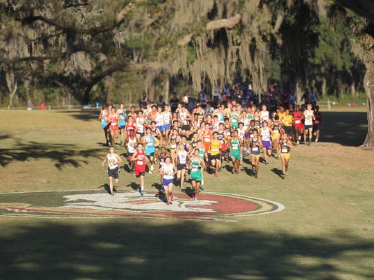 Runners take off during the start of the boys select race during October's FSU Invitational at Apalachee Regional Park.