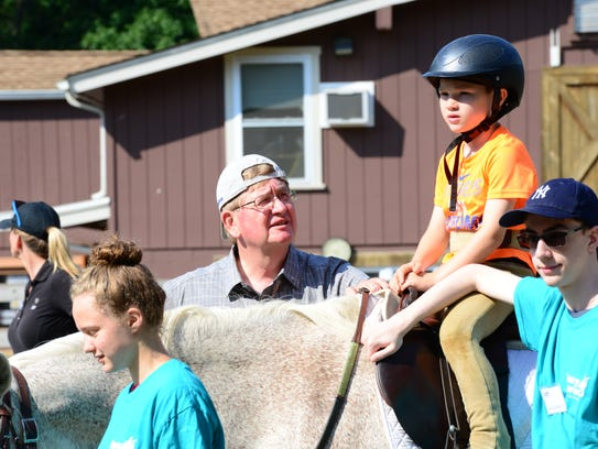 James sits on his horse while retired Police Chief