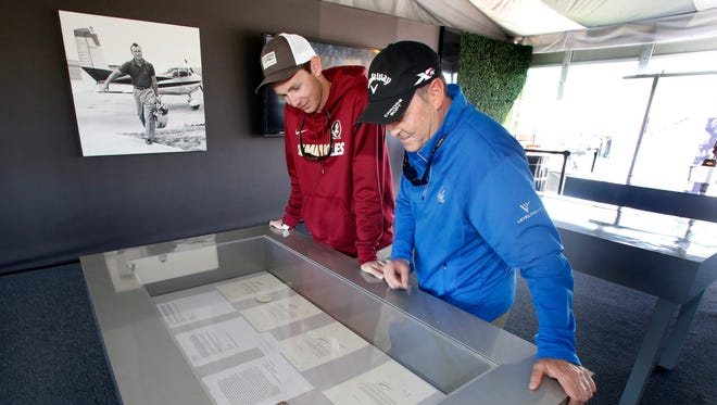 Austin Man (left) and his father Bill Man look at a series of personal letters written to and by Arnold Palmer that are on display in the MasterCard pavilion during the first round of the Arnold Palmer Invitational golf tournament at Bay Hill Club and Lodge.