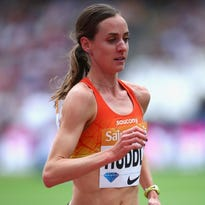 Molly Huddle runs to a second-place finish Saturday in the women's 5,000 meters at a Diamond League meet in London.