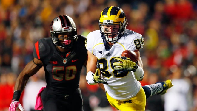 Michigan tight end Jake Butt makes a catch against Rutgers on Oct. 4, 2014, in Piscataway, N.J.