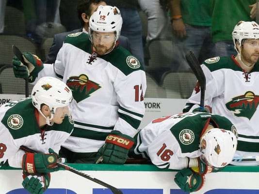 Minnesota Wild Ryan Carter (18), David Jones (12), Jason Zucker (16) and Justin Fontaine (14) react on the bench after  the the third period in Game 2 in the first round of the NHL Stanley Cup playoffs against the Dallas Stars, Saturday, April 16, 2016, in Dallas. (AP Photo/LM Otero)