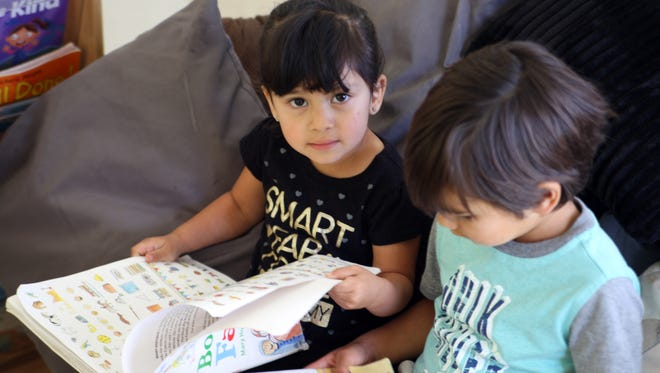 Pre-school students reading at Crescita Early Education Center, Salinas