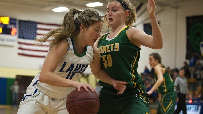 BFA's Kelly Laggis (30) defends Colchester's Lauren Bergen during a  high school girls basketball playdown game last month.