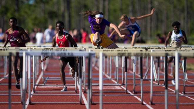 Fort Pierce Central's Ethan Mulrooney (center) pulls ahead to take first place in the 110-meter hurdles during the Port St. Lucie Invitational track and field meet Thursday, March 29, 2018, at Port St. Lucie High School. Mulrooney also took first in the 300-meter hurdles.