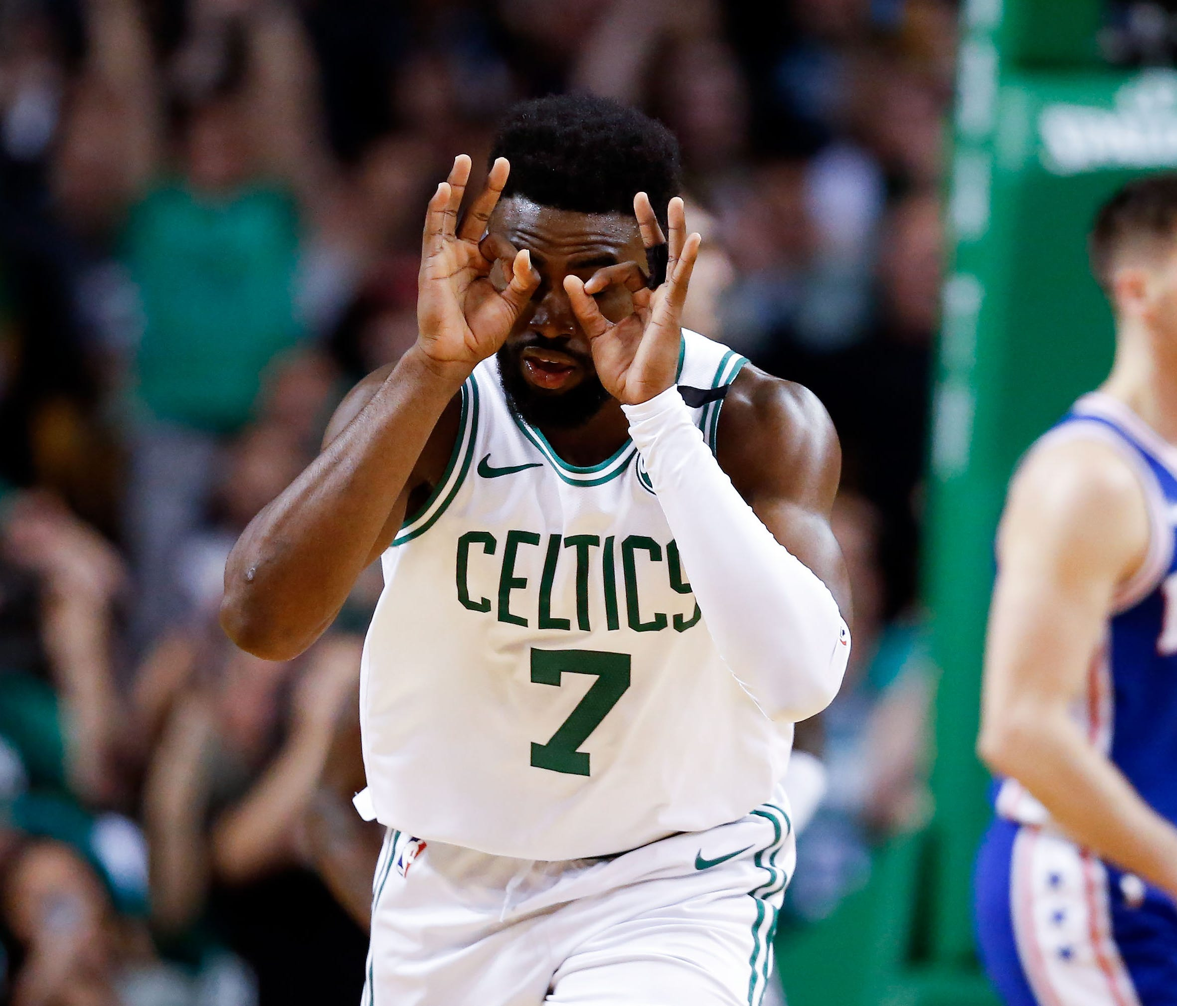 Boston Celtics guard Jaylen Brown (7) reacts after scoring against the Philadelphia 76ers during the second half in game five of the second round of the 2018 NBA Playoffs at the TD Garden.