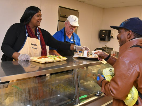 Eryx Knight, at right, was the ceremonial recipient of the 2 millionth meal served by Daily Bread, Inc., which opened 30 years ago in Melbourne. Among those serving the meal of chili and cornbread, since that was the first dish on opening day, is the new Executive Director, Kathleen Spears, PhD. In the center of photo is volunteer Rich O'Connor.