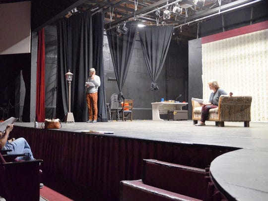 "From left to right, Mike Dick (reading in seats), Mike Cook and Lennie Marie Brown in a scene from ""Crosstown,"" a play featured in the One-Act Play Festival."