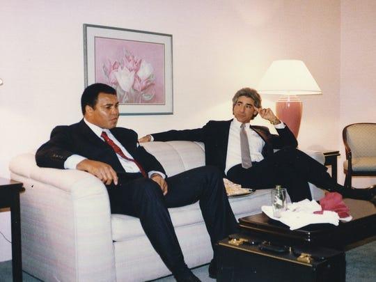 Dr. Stuart Kirchenbaum sits  with Muhammad Ali in 1981.