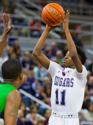 St. Thomas More's Jonathan Cisse shoots against Bossier during the play-off game in the LHSAA Boy's Top 28 Semi-Finals in Lake Charles March 10, 2016.