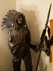 Charlie DeVille's American Indian statue stands in his bedroom at his Broadmoor home August 2, 2016.