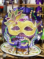 A Mardi Gras themed platter on sale at Caroline and