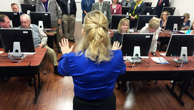 Assistant Director of Instruction Jennifer Brown (center) speaks during the retreat of the Sumner County Board of Education on Friday, Nov. 6, when they took a sample TNReady test.