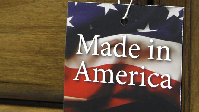 "Bob Leverone/AP The vast majority of Americans say they prefer lower prices to paying a premium for items labeled ?Made in the USA.? In this March 16, 2012 file photo, a ""Made in America"" tag hangs on a chest of drawers at a furniture factory in Lincolnton, N.C. The vast majority of Americans say they prefer lower prices instead of paying a premium for items labeled ""Made in the U.S.A.,"" even if it means those cheaper items are made abroad, according to an Associated Press-GfK poll.  (AP Photo/Bob Leverone, File)"