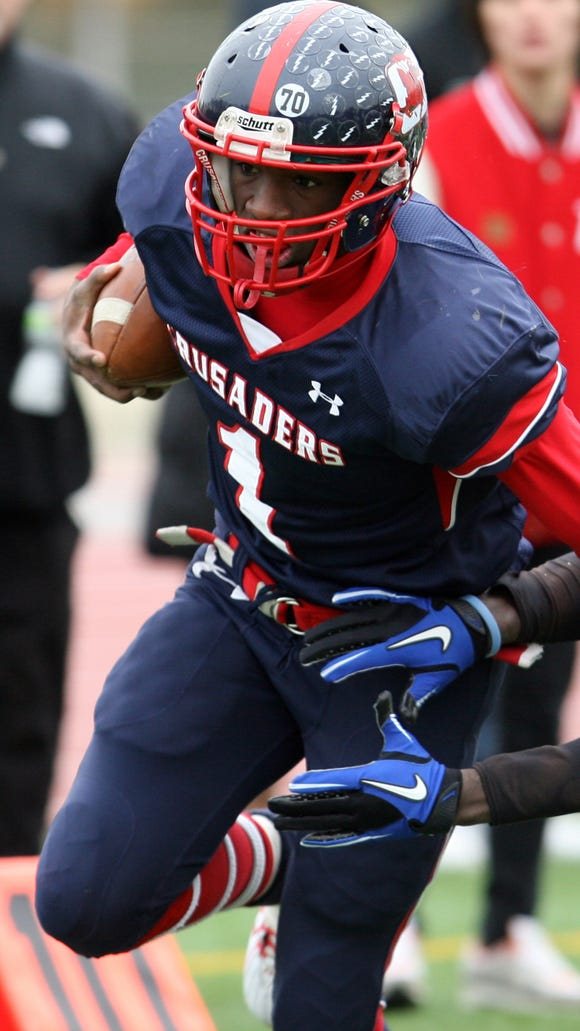 Quarterback Tyrell Goodman of Stepinac breaks tackles as he runs against White Plains during their annual Turkey Bowl game at White Plains High School Nov. 25, 2010. Stepinac defeated White Plains 42-14.