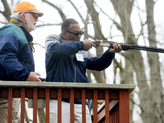 Former Penn State running back Blair Thomas fires at clay pigeons during Penn State York's seventh annual clay shoot event on Thursday at Central Penn Sporting Clays in Warrington Township.
