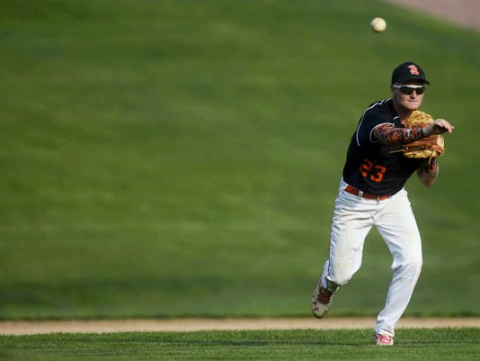 York Suburban's Jesse Mowry throws to first for an out during an American Legion baseball game at York Suburban High School on Wednesday. York Suburban won, 1-0.