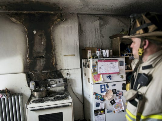 Duane Trautman, Lebanon City fire commissioner, inspects the apartment for a cause of a fire as Lebanon City fire crews battle a fire at 342 N. 7th St., Wednesday afternoon on June 17, 2015. Crew were on scene for over an hour. Jeremy Long -- Lebanon Daily News