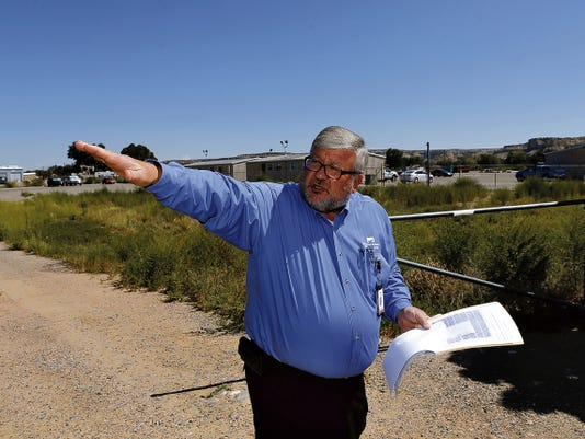 Doug Frary, the professional and support services vice president for the San Juan Regional Medical Center, talks Frida near the boundary of a proposed solar farm in Farmington.