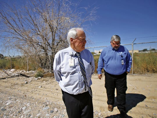 San Juan Regional Medical Center Chief Operating Officer John Buffington, left, and Vice President of Professional and Support Service Doug Frary visit the site of a proposed solar energy farm in Farmington in September.