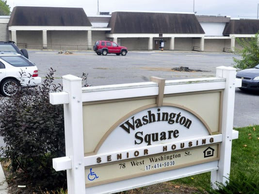 Residents of Washington Square Senior Housing development may have new neighbors, if borough officials approve a plan to demolish the old County Market building and replace it with 54 apartment and townhouse units.