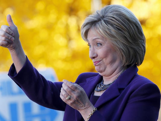 Democratic presidential candidate Hillary Rodham Clinton acknowledges supporters after filing papers to be on the nation's earliest presidential primary ballot, Monday, Nov. 9, 2015, in Concord, N.H. (AP Photo/Jim Cole)
