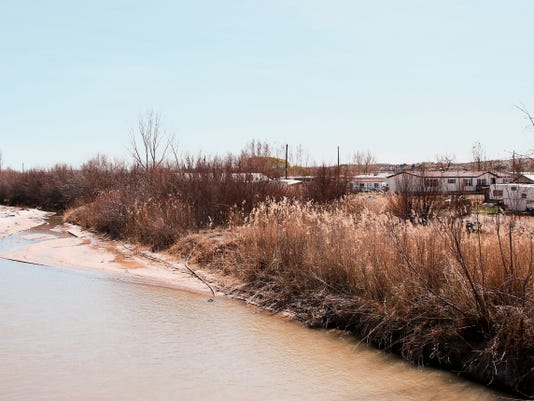 The San Juan River runs County Road 5500 in Farmington on Thursday.