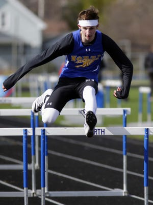 Sheboygan North's Julian Tichy leaps over a hurdle while winning the 110-meter hurdles on Monday.