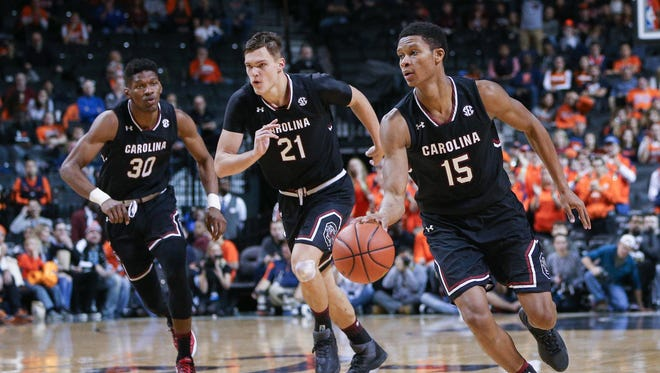 South Carolina Gamecocks guard PJ Dozier (15) carries the ball up court with forward Maik Kotsar (21) and forward Chris Silva (30) against the Syracuse Orange during the second half of the Brooklyn Hoops Holiday Invitational at Barclays Center.  South Carolina won, 64-50.  Mandatory Credit: Vincent Carchietta-USA TODAY Sports
