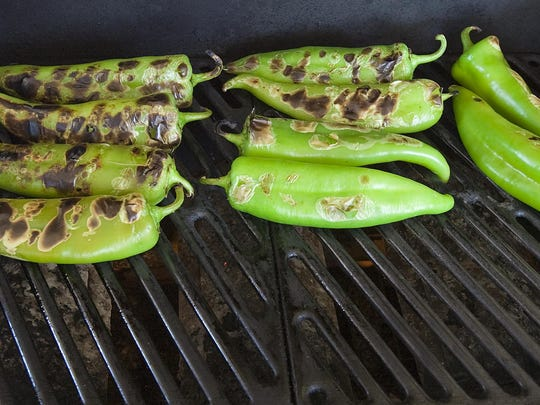 New Mexico Hatch chiles blistering on the grill.