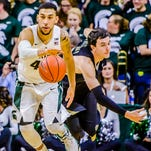 Denzel Valentine ,left, of MSU steals the ball from Trent Whiting of Arkansas-Pine Bluff during their game Friday in East Lansing.