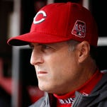 Cincinnati Reds manager Bryan Price stands in the dugout in the fifth inning inning of a baseball game against the Chicago Cubs, Thursday, Oct. 1, 2015, in Cincinnati. (AP Photo/John Minchillo)