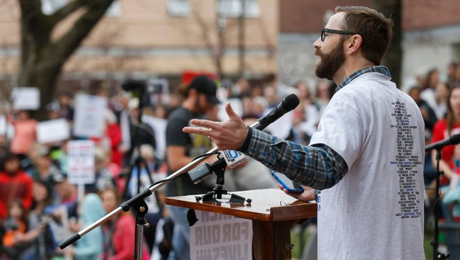 Phil Snider speaks to the crowd during the March For Our Lives rally at Park Central Square on Saturday, March 24, 2018.