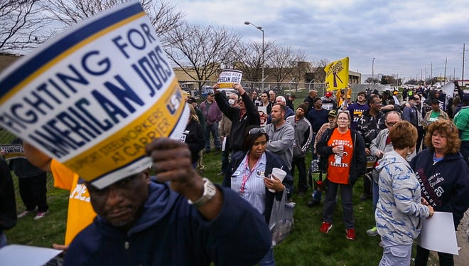 Hundreds of workers gathered outside the Carrier Corp. plant on Indianapolis' west side to protest the loss of their jobs to Mexico.